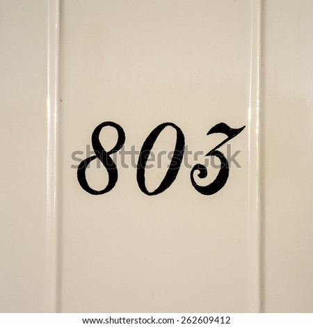 hand painted house number eight hundred and three - stock photo