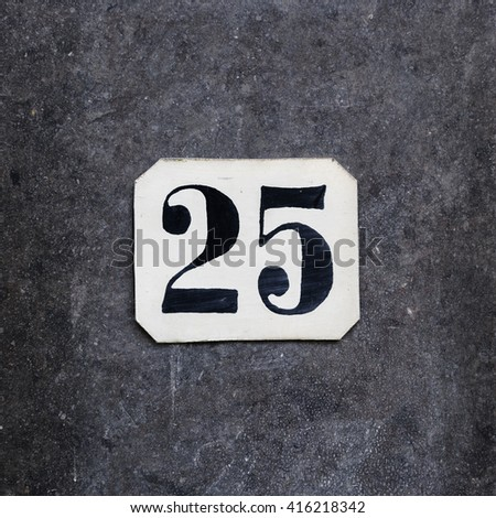 hand painted house number twenty five - stock photo
