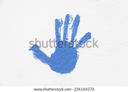 Hand painted on the wall, detail of a hand painted blue textured background, silhouette - stock photo