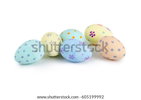 Hand-painted pastel-colored easter eggs over white background