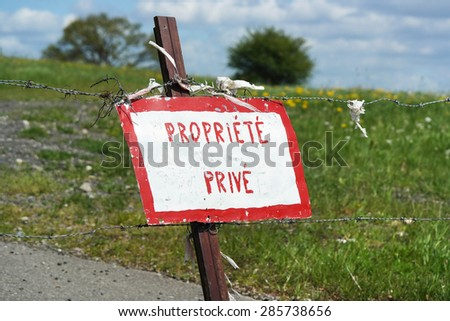 Hand painted sign indicates in French: propriété privé, means private property - stock photo