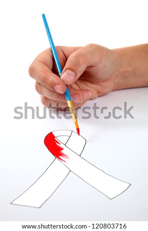 Hand painting a AIDS ribbon - stock photo