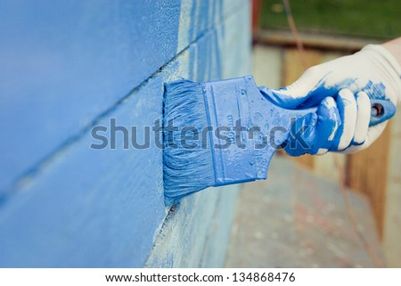 hand painting blue wooden wall - stock photo