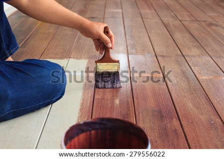 hand painting oil color on wood floor use for home decorated ,house renovation and housing construction theme - stock photo