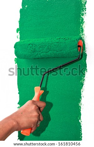 Hand painting wall In the bedroom - stock photo
