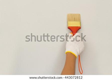 Hand painting walls  - stock photo