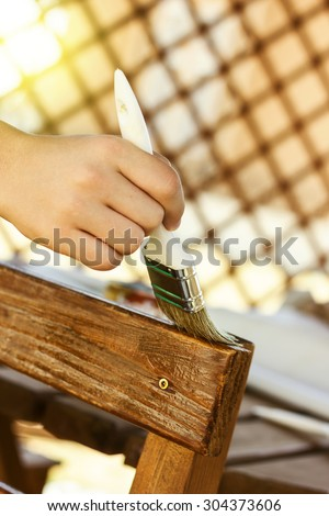 hand painting with brush the wooden background of chair and table - stock photo
