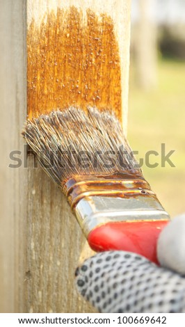 Hand painting wood - stock photo