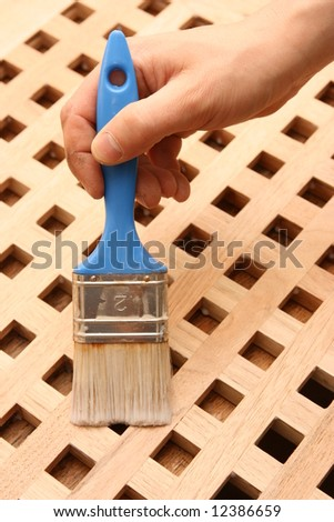 Hand painting wooden furniture piece - stock photo