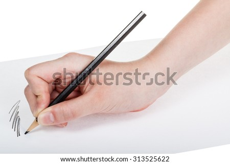 hand paints by wood black pencil on sheet of paper isolated on white background
