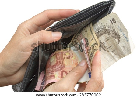 Hand paying by british banknote, ten euro banknote and the ten dollar banknote in wallet isolated on the white background. - stock photo