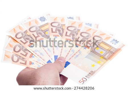 Hand paying with fifty euro fan isolated on white background - stock photo