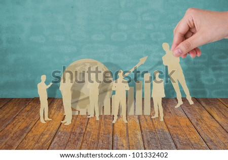 Hand pick paper cut of  business man - stock photo
