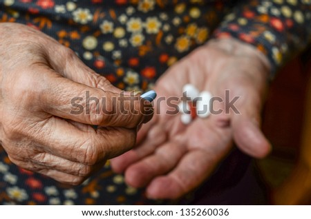 hand picking pill from palm - stock photo