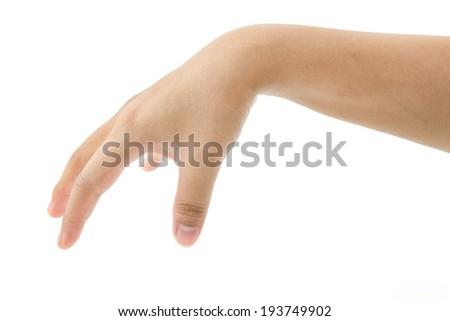 Hand picking something isolated on white background - stock photo