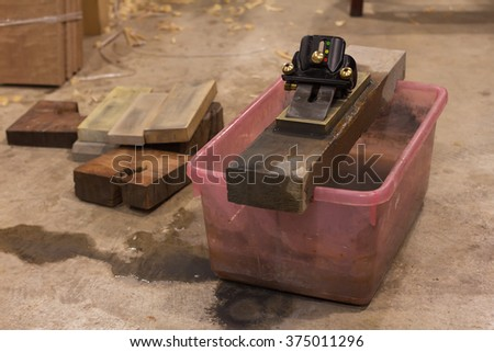 Hand plane/cutting iron and whetstone /select a specific focus - stock photo