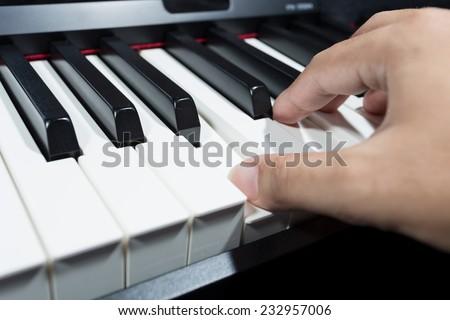 hand play digital piano - stock photo