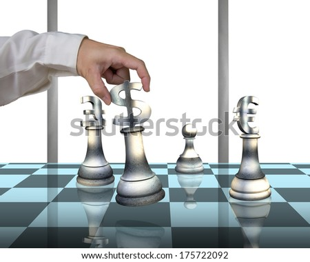Hand playing chess with money symbol pieces on table in white background - stock photo