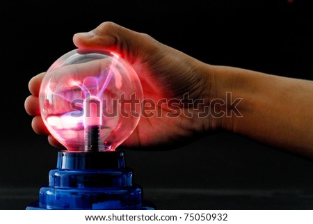 Hand Playing with a Plasma Tesla Ball
