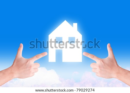 hand point to house icon on the sky - stock photo