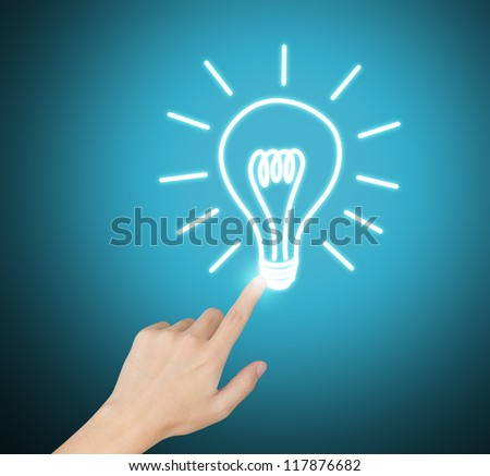hand pointing at electric light bulb - stock photo