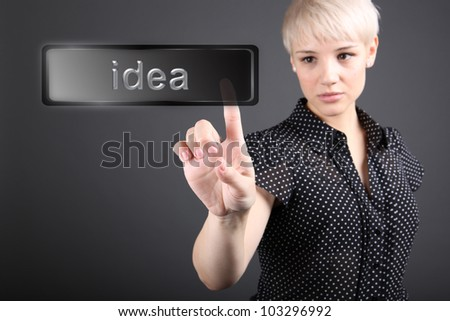 Hand pointing at idea - business concept - stock photo