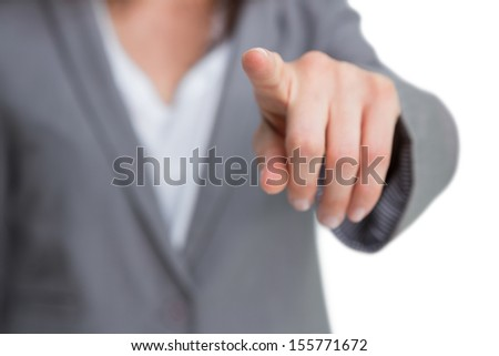 Hand pointing at screen against white background