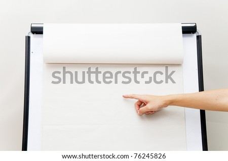 hand pointing on flip chart - stock photo