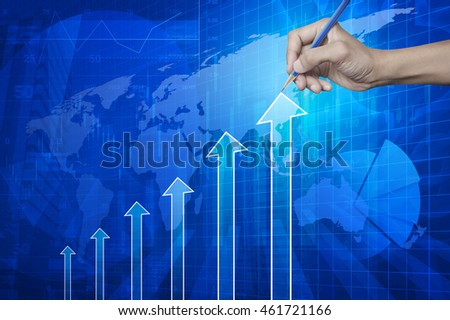 Hand pointing pencil to arrow head with financial chart and graph on city and map background, Elements of this image furnished by NASA