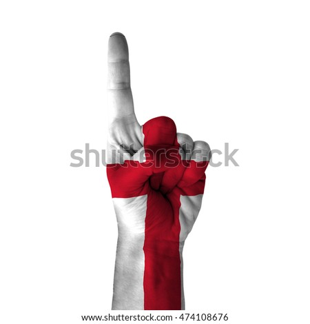 Hand pointing thumb up direction, england painted with flag as symbol of up direction, first and number one symbol - isolated on white background