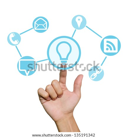 Hand pointing to business symbols and icons - stock photo
