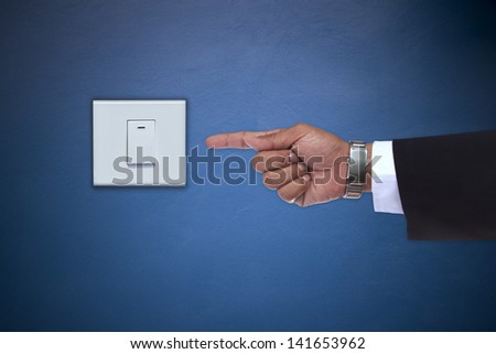 hand pointing to switch of electric appliance use for save energy topic - stock photo