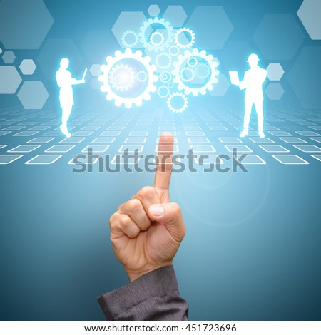 Hand pointing to Team work concept with gear system - stock photo