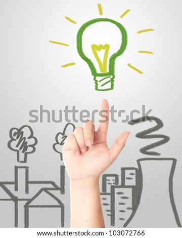 Hand pointing to the hand draw green light bulb with factories and Nuclear plant pollution. Concept for eco and global warming - stock photo