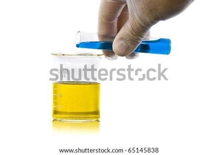 hand pouring liquid chemicals into flask