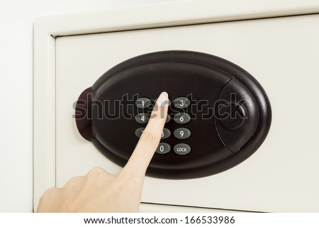 hand press key on safety box for open - stock photo