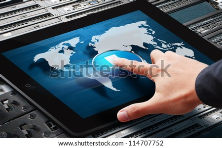 Hand press on power button on world map from digital tablet - stock photo