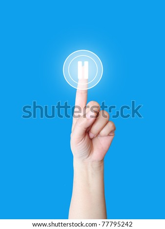 Hand press pause button - stock photo