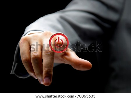Hand press power button on touch screen - stock photo