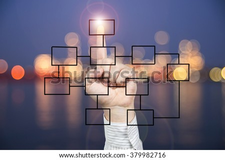 Hand press the glowing button and chart on whiteboard - stock photo