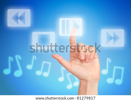 Hand pressing button play and musical notes - stock photo