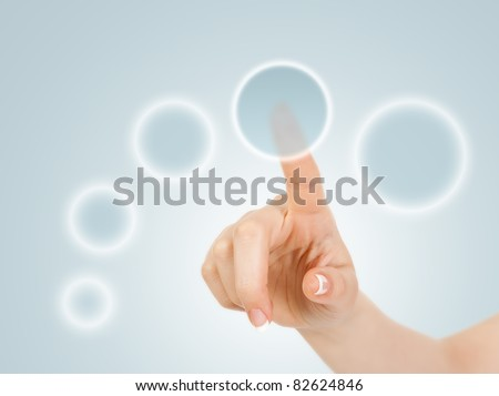 Hand pressing circle virtual buttons - stock photo