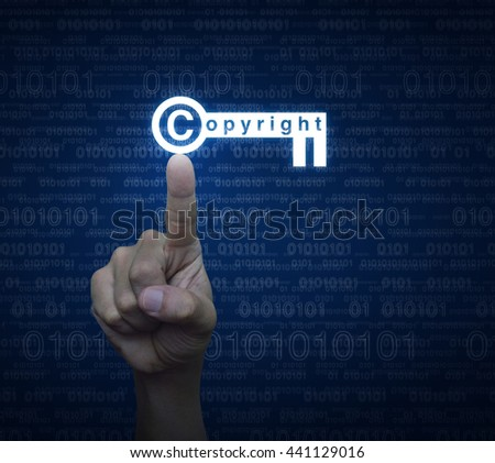 Hand pressing copyright key icon over computer binary code blue background, Copyright and patents concept - stock photo