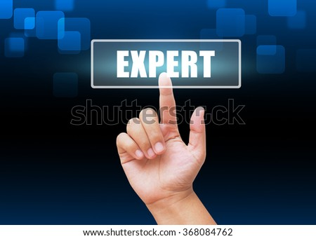 Hand pressing Expert button with technology background - stock photo