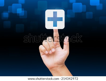Hand pressing First Aid sign medical background - stock photo
