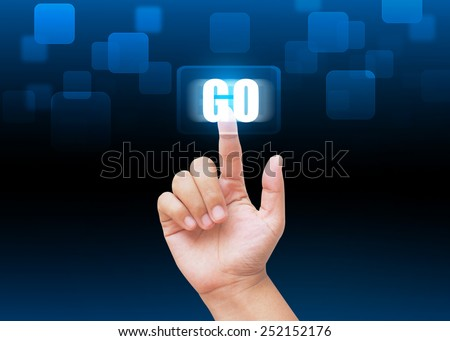 Hand pressing GO buttons with technology background  - stock photo