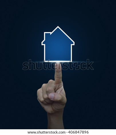 Hand pressing house icon with copy space on blue background, Real estate concept