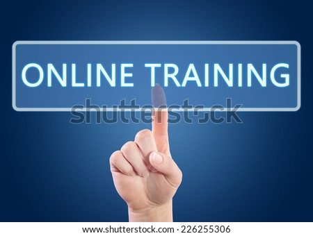 Hand pressing Online Training button on interface with blue background. - stock photo