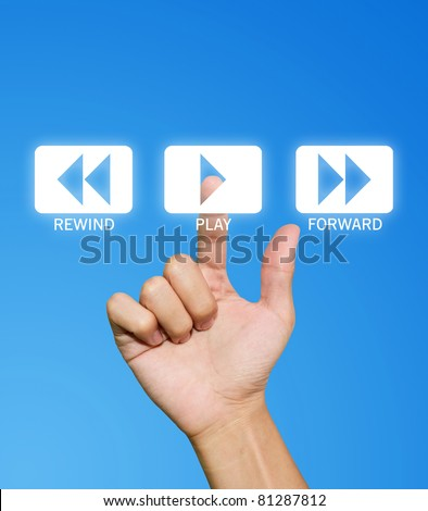 Hand pressing play button on the blue background - stock photo