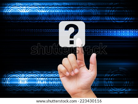 Hand pressing question mark on technology background